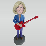 Custom woman and guitar bobbleheads