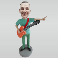 Personalized custom man and guitar bobble heads