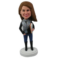Custom sweet smile female standing with one hand in pocket, one hand holds a book in her arms bobble heads