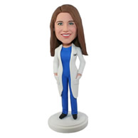 Custom female doctor in white coat blue suit underneath bobble heads