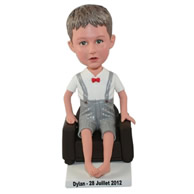 Custom barefeet little boy dressing in handsome clothes sitting in the chair bobble heads
