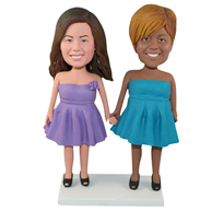 The two women in the skirt custom bobbleheads