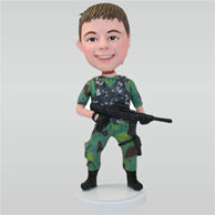 Soldier in jungle fatigues holding a machine gun custom bobbleheads