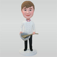 Man in white sweater holding a big spoon and a big bowl custom bobbleheads
