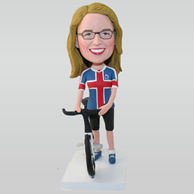 Custom woman bobblehead in flag pattern T-shirt with her bicycle