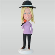 Woman in purple T-shirt holding a microphone custom bobbleheads