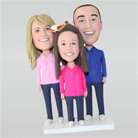 Father in blue shirt and mom in pink shirt with their lovely daughter in rose shirt custom bobbleheads