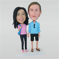 Husband in blue shirt and wife in pink shirt custom bobbleheads