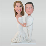 Groom in white suit and bride in white wedding dress custom bobbleheads