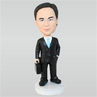 Business man in black suit holding a briefcase custom bobbleheads
