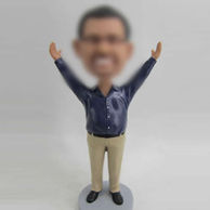 Blue shirt bobble head doll