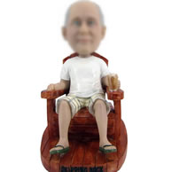 Bobblehead doll of on the Chair