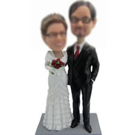 Custom bobbleheads of  Wedding cake