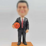 Boss with basketball bobble head doll
