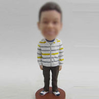Boy bobble head doll