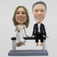 Wedding Couple Bobbleheads sitting on a bench-10744