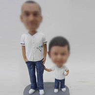 Dad and son bobble head doll