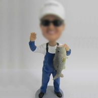 Man with fish bobble head doll