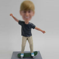 Skateboard boy bobble head