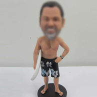 Surfing bobble head doll