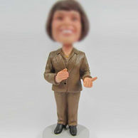 Woman in suit bobble head doll